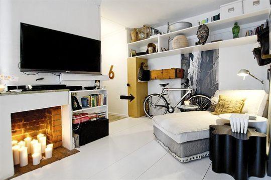 Bolig indretning studiebolig lejlighed lille stue sovevaerelse pejs